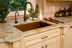 granite with cream cabinets