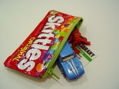 DIY- Sweet Tooth Pouch- tutorial. Learn how to turn candy wrappers into fun pouches. Add a strap on as a purse too!