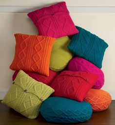 Hand-Knit Sweater Pillow Covers: Crafted by fair trade artisans in Nepal, these vibrant pillows are made from 100% natural wool, a sustainable resource, with coconut shell closings