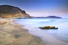 seascape,sunset,beach,purple,waves,water,horizontal,cabo de gata, national park, spain, almeria, volcanic, colorful,outdoors, nature, landscape, exterior, europe, photography color, landscapes, sea, beaches, colorful, landscapes, coast, wave, coasts,coast,dusk,evening,sundown,nightfall,cloud, clouds,unrise, stone, stones,rock, rocks,blue,pink,