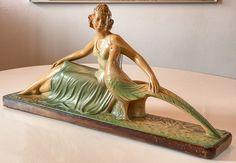 Online veilinghuis Catawiki: Arnova 328 - Schouw Beeld Art Deco van vrouw met pauw - van gips