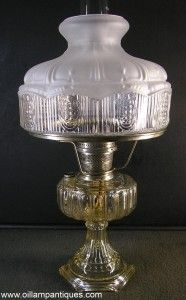 The Aladdin Cathedral lamp was only produced in 1934 and was available in three colours - clear, amber and green. This kerosene lamp is the clear variety.