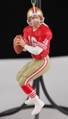 1995 Hallmark Keepsake Joe Montana Christmas tree ornament.  This is the first in the Football Legends Collector's series.  The Joe Montana ornament is posed as getting into position to throw the football.  Red and gold San Francisco 49ers colors.  No. 16, Joe Montana is made of plastic with a metal hook for hanging.  The Christmas ornament is about 4 1/4 inches high.
