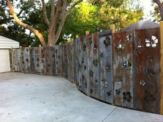 Pinned Image  Industrial Chic- reclaimed 100 year old tin roofing repurposed into a fantasy privacy fence.