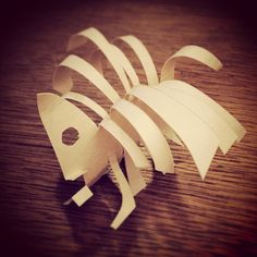 New animal or fish bone. One card paper folding sculpture.