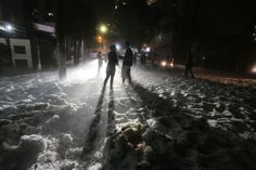 Week of May 17-23, 2014 Ice covers a street after a hailstorm hit the city of São Paulo in southeastern Brazil. Nilton Fukuda/DPA/Zuma Press