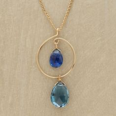 TWO SOULS NECKLACE--A twist of 14kt goldfill entwines kyanite and London blue topaz in Thoi Vo's interpretation of the meeting of two souls. Lobster clasp. Handmade in USA. Approx. 15 to 18L.