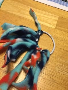 At our kitten shower, we had people make fleece spiders.  I thought I would share how to make them.   For this toy you need fleece, hair rub...