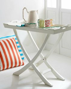 Serve up some beach style with these handmade folding tray tables that are hand-painted and hand finished for a perfectly weathered look.