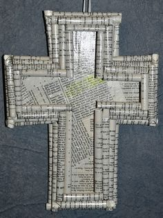 Cross (decoupage, I'm assuming) made from recycled Bible pages. The effect is lovely -- the Word. I never know what to do with Bibles (especially cheap ones people have given me) that are worn beyond usefulness. Trying to decide if this would be considered a beautiful solution... Or irreverent... What do you think?