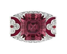 The top of this Louis Vuitton ring reveals two iconic LV motifs surrounding the large red spinel from Tanzania. From the Voyage dans le Temps Dentelle de Monograme collection 2013.