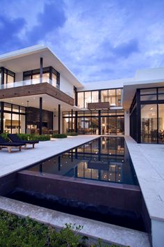 contemporary modern home residential architecture:wooden balcony, pool , floor to ceiling windows (it)