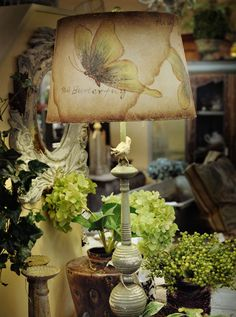 Accessories including lamps, mirrors and florals --and always a nest