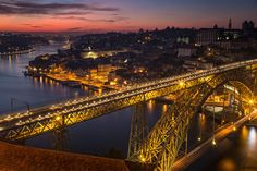 Porto Through The Lens - Words and Photography by Pete Heck 23.11.2015 | Porto, Portugal invigorated my creative side. My photography sessions gave me many reasons to love this city. Photo: Porto Bridge Lit Up