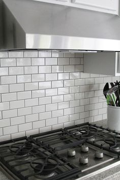 Jennifer Stagg of With Heart chose dark grout when she created a subway tile backsplash in her kitchen. It looks gorgeous. She shows you how she installed it on her blog. || @jennifer_stagg