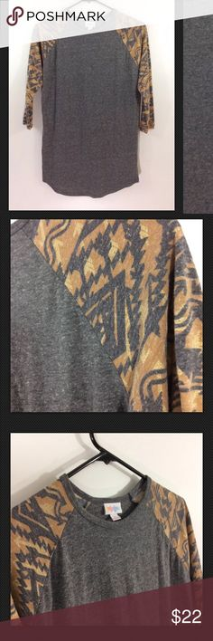 "LuLaRoe Randy Slub Baseball Tee Gray Gold GEO LuLaRoe Randy Slub Baseball Tee   Gray & Gold  GEO Sleeves  Excellent condition  NO TEARS, FLAWS OR STAINS Freshly Cleaned   Size: Small   Pit to pit: 19""  Length: 26""   Thanks for checking out my Closet! LuLaRoe Tops Tees - Long Sleeve"