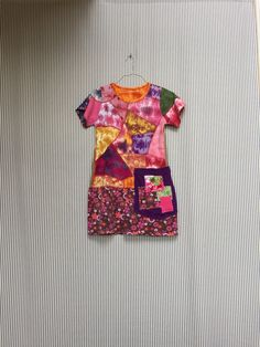 A personal favorite from my Etsy shop https://www.etsy.com/listing/509281738/upcycled-colorful-tunic-top-funky