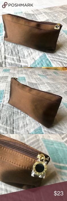 """NWOT Bvlgari Makeup Pouch Perfect condition. Still has the plastic on the zipper pull because I never got around to using it. Beautiful Bvlgari brown make-up pouch with gorgeous satin lining. Perfect size. Measures 4.5"""" tall, 9"""" long and 2"""" wide. Reasonable offers and questions always welcomed ☺️ Bvlgari Bags Cosmetic Bags & Cases"""
