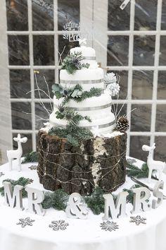 Cake Table Wood Slice Rustic Pine Greenery White Silver Gorgeously Glam New Years Eve Wedding http://www.photographybykrishanthi.co.uk/