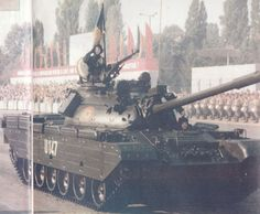 A T-55 main battle tank of the Romanian People's Army rolling through Aviators' Square in Bucharest at the 1984 Romanian Liberation Day Parade.