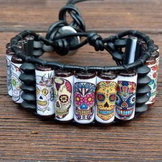 Sugar Skull Cuff Bracelet - Black Leather, Dia De Los Muertos, Day of the Dead Skulls from ElectricPenguin on Etsy. Saved to Jewelry. Paper Jewelry, Beaded Jewelry, Jewelry Gifts, Sugar Skull Art, Sugar Skulls, Skull Jewelry, Skull Bracelet, Jewlery, Day Of The Dead Skull