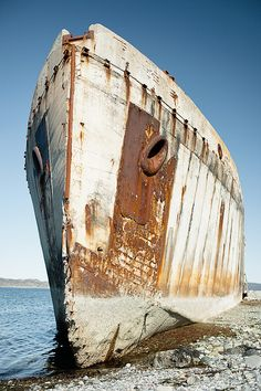 The concrete ship ran ashore in 1942 and has survived several attempts to sink it.  just outside of Trondheim in Norway.