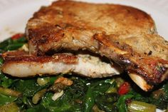 Garlic Mustard Pork Chops served on a bed of spinach: 4 pork chops, 1/4-inch thick; Salt and pepper, to taste; ½ cup Dijon mustard; 1 teaspoon mustard powder; 1 teaspoon dried french thyme; 1 teaspoon crushed garlic; 1 tablespoon coconut oil