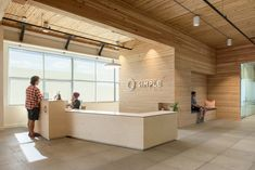 "Hacker Architects have designed the new offices of online banking company Simple, located in Portland, Oregon. Designed around the idea of a ""home"" for Simple rather than a corporate office,… Corporate Office Design, Office Reception Design, Bureau Design, Office Workspace, Office Decor, Staff Lounge, Banks Office, Lobby Reception, Reception Desks"