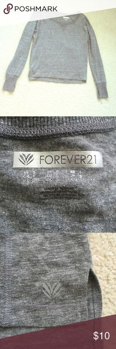 Forever 21 top! Got it in the sports/athletic department but you could wear it whenever and where ever you want. Only worn once, great condition! IT COULD ALSO FIT A MEDIUM! Forever 21 Tops Tees - Long Sleeve