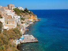 Syros beach by DangerousBiz, via Flickr