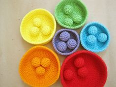 Crochet Pattern: Color Sorting Balls. These go with the nesting bowls (pictured) pattern called 'Rainbow Nesting Bowls (rewritten)' that I pinned earlier. What a great learning (not to mention FUN) activity for kids! What a fun display for me! �\_(?)_/�.