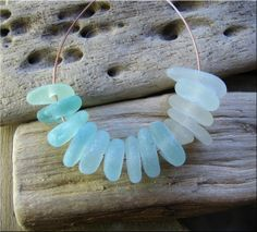 14 Natural sea glass beads, middle drilled, supplies (2) £9.10