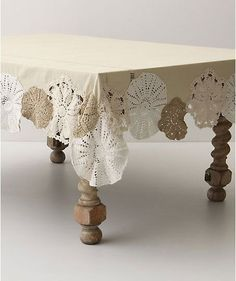 Doilies hanging off table cloth idea