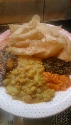 Trinidad bussup shot roti and curry mango,curry channa and potatoes, fry bodi and pumkin dip.