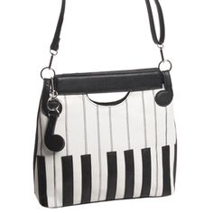 This sleek animal-friendly handbag has the look and touch of real leather, with embroidery detail on the keyboard design, and subtle eighth notes holding the shoulder strap.Vinyl, 12
