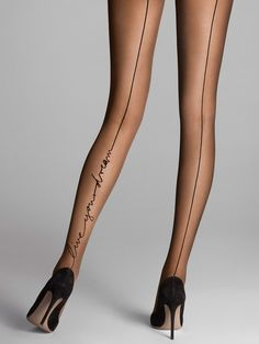 """An elegant backseam writes along the length of the left leg in cursive words """"Live your dream"""" and creates an eye-catching embellishment.  Sheer, matte tights  Wide grip edge at hem for durability  Pleasantly soft knitted waist Sophisticated for both day and night."""