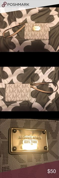 🤑LIKE NEW! MICHAEL KORS MINI WRISTLET WALLET💕 Like NEW vanilla MK logo mini wristlet wallet! Super cute and perfect to use for the smaller bags!!! Michael Kors Bags Clutches & Wristlets