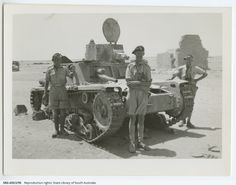 Three Australian soldiers standing by a tank. Note on back: 'Wop tank MII captured near Sidi Barrani seen whilst on recce to Fwd area. Aug 41. Tubbs and Teddy Foster.'- pin by Paolo Marzioli