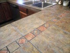 Find This Pin And More On Countertops Tile Kitchen Countertop Ideas