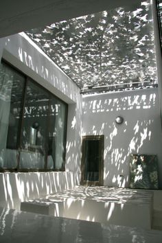 Casa Encuentro, Almeria, Spain. Inner courtyard with sliding fig leaf roof http://www.organicholidays.co.uk/at/3237.htm