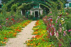 By the end of summer, these nasturtiums will fill the entire walkway in Monet's garden. Garden Beds, Garden Paths, Annual Flowers, Outdoor Landscaping, End Of Summer, Zinnias, Dream Garden, Permaculture, Garden Planning