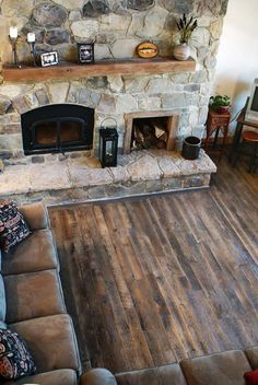 Reclaimed Oak Hardwood Floor and Stone Fireplace. Refinish Wood Floors, Rustic House, Wood Stove Fireplace, Best Flooring, New House Plans, Farmhouse Flooring, Remodeling Inspiration, Log Cabin Decor, Farmhouse Style House