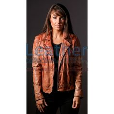 Ginger Women Leather jacket has been made from authentic Calf skin which has been dyed then stone washed with a hint of dull wax to give it that edgy warn look. Featuring metal zip for front fastening and side pockets, adjustable strap buckle on the waist and shoulder epaulettes with snap button