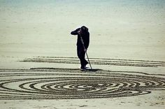 Drawing on the sand of Peter Donnelly