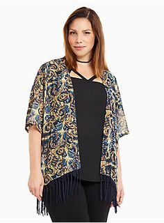 "Who says Whovians can't be stylish too? This easy-breezy chiffon kimono looks hand-painted with a van Gogh-inspired TARDIS print. Trimmed with navy fringe for a moving-and-shaking effect.<div><br></div><div><b>Model is 5'9.5"", size 1 <br></b><div><ul><li style=""LIST-STYLE-POSITION: outside !important; LIST-STYLE-TYPE: disc !important"">Size 1 measures 26"" from shoulder</li><li style=""LIST-STYLE-POSITION: outside !important; LIST-STYLE-TYPE: disc !important"">Polyester</li><li styl"