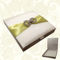 Modern silk wedding invitation box with new rhinestone brooch design and padding all over. Modern and stylish!