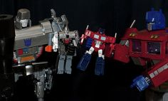 Megatron and Optimus playing with their Transformers.