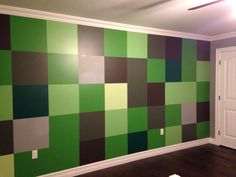 """Minecraft wall we painted for my son. 18""""x18"""" squares. All the paint colours were mistimes from local home improvement stores!"""