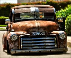 chevy chevrolet gmc advanced design pickup truck slammed laid out sitting on the ground in a rusty patina finish and an equally rough visor.
