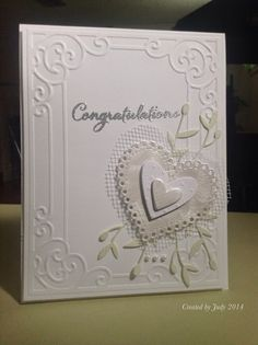 https://flic.kr/p/o41xo9 | Wedding Card | A card that I made for one of my co-workers getting married in July. Dies used: SSS Small Heart Doily SSSD111326 Lawn Fawn Hearts LF492 Memory Box Small Olive Branch 98803 Other supplies: Cuttlebug Scrollwork embossing folder Stampendous sentiment - Loving Messages set SSC1199 Silver embossing powder, pearls and some white tuille Thanks for looking!